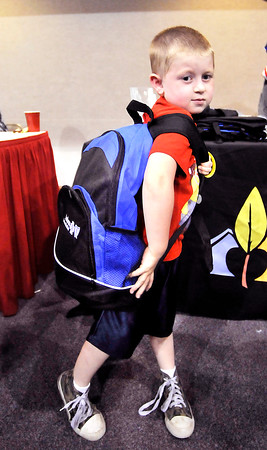John P. Cleary | The Herald Bulletin<br /> James McConnell, 6, a first grader at Alexandria-Monroe Elementary School, shows off his new backpack loaded with school supplies he received at the Back-to School Rally for Alexandria students this past week for the start of school.
