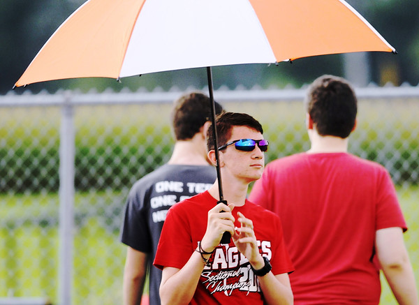 Don Knight   The Herald Bulletin <br /> Elijah Hahn, a member of the Frankton pep band, waits out a rain delay as the Eagles hosted the Lapel Bulldogs on Friday. The game was postponed until today at 11 a.m.