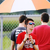 Don Knight | The Herald Bulletin <br /> Elijah Hahn, a member of the Frankton pep band, waits out a rain delay as the Eagles hosted the Lapel Bulldogs on Friday. The game was postponed until today at 11 a.m.