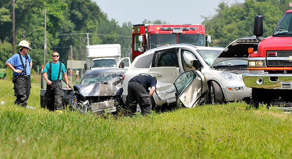 John P. Cleary   The Herald Bulletin<br /> Fire and rescue personnel look over the scene of a late-morning three vehicle fatal crash on Indiana 37 south of Elwood near Indiana 128. One person died in the accident and four others were sent to area hospitals, two by medical helicopters.