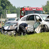 John P. Cleary | The Herald Bulletin<br /> Fire and rescue personnel look over the scene of a late-morning three vehicle fatal crash on Indiana 37 south of Elwood near Indiana 128. One person died in the accident and four others were sent to area hospitals, two by medical helicopters.