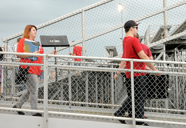 Don Knight | The Herald Bulletin<br /> Frankton's pep band carries their equipment out of the bleachers after the game was postponed due to lightning in the area on Friday. The game will be played today at 11 a.m.