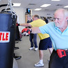Don Knight | The Herald Bulletin<br /> Denny hodge hits a punching bag during a Rock Steady Boxing workout on Friday. Community Hospital Anderson launched a Rock Steady program for Parkinson's patients.