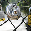 Don Knight | The Herald Bulletin<br /> A trio of love locks are attached to the bridge over the falls at Falls Park in Pendleton. An anonymous note on the bridge encourages the town to start a new tradition of couples attaching a lock to the bridge and throwing the key into the creek as a symbol of their lasting love.