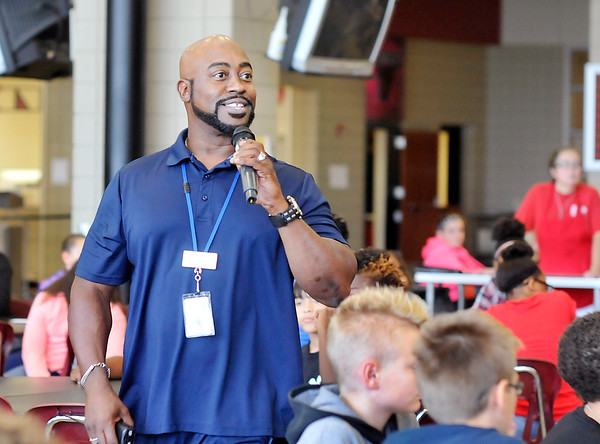 John P. Cleary   The Herald Bulletin<br /> Samuel Jackson, Life Coach at Highland Middle School, talks to students during their lunch period.