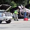 John P. Cleary | The Herald Bulletin<br /> Authorities investigate a two-vehicle accident Thursday morning at Rangeline Road and East 38th Street that left one person dead.