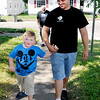 Don Knight   The Herald Bulletin<br /> Michael Brown walks his son Trenton home from the bus stop on Thursday. Trenton has Schizencephaly, a developmental birth defect that is characterized by abnormal slits or clefts in the cerebral hemispheres of the brain.