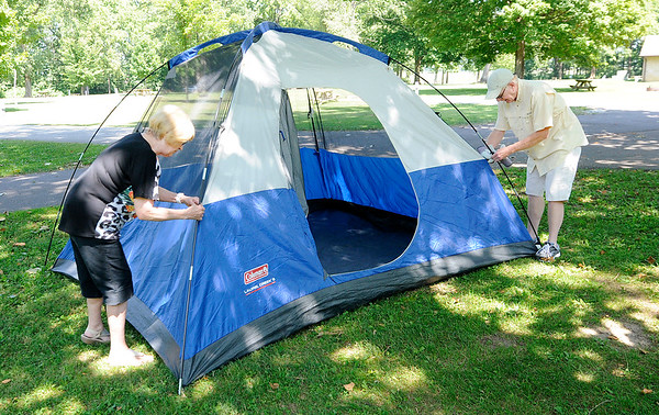 Don Knight | The Herald Bulletin<br /> Barb and Earl Shell of Anderson set up their tent at Mounds State Park on Wednesday.