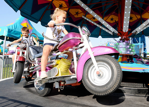 Don Knight | The Herald Bulletin<br /> Willow Leisure, 5, rides a motorcycle ride during the Elwood Glass Festival on Friday.