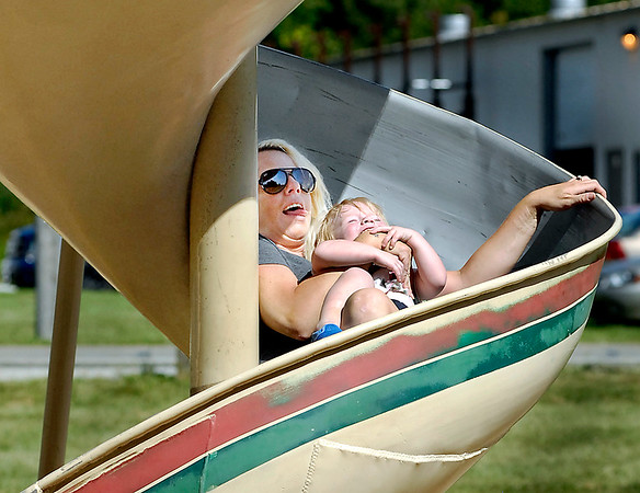 John P. Cleary    The Herald Bulletin<br /> Casey Woodruff laughs with her two-year-old daughter Charlee Woodruff as they go down the spiral slide together at the Shadyside Park playground Tuesday afternoon. They were out on a family outing to the park enjoying the nice weather.