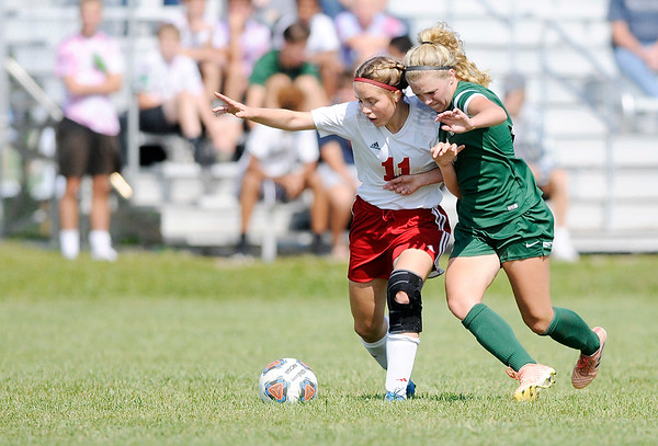 Don Knight   The Herald Bulletin<br /> Pendleton Heights Taylor Fort and West Lafayette's Amelia Givan fight for control of the ball during the Arabians soccer invitational on Saturday.