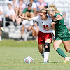 Don Knight | The Herald Bulletin<br /> Pendleton Heights Taylor Fort and West Lafayette's Amelia Givan fight for control of the ball during the Arabians soccer invitational on Saturday.