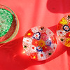 Don Knight | The Herald Bulletin<br /> Glass paperweights for sale at the booth of the Community Service Club of Elwood during the Glass Festival on Friday. The group is also holding a drawing for a glass lamp.
