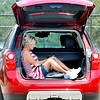 John P. Cleary |  The Herald Bulletin<br /> Linda Bush, of Anderson, checks her messages as she relaxes in the back of her SUV after doing her workout walk around the Shadyside Park trails Monday afternoon.