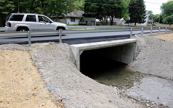 Don Knight | The Herald Bulletin<br /> Alexandria Pike reopens<br /> Traffic travels across the new box culvert installed on Alexandria Pike on Tuesday. Wet weather delayed the completion of the project.