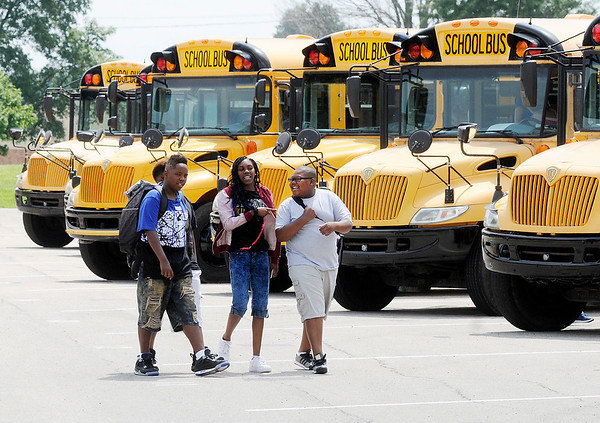 Don Knight   The Herald Bulletin<br /> Highland Middle School students load onto buses at the end of the first day of school on Wednesday.