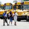 Don Knight | The Herald Bulletin<br /> Highland Middle School students load onto buses at the end of the first day of school on Wednesday.
