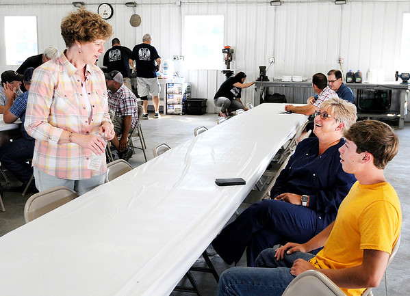 Don Knight | The Herald Bulletin<br /> Rep. Susan Brooks talks to Tracy and Brock Bracken as local farmers gathered at Bracken Farms for a Shop Talk on Wednesday.