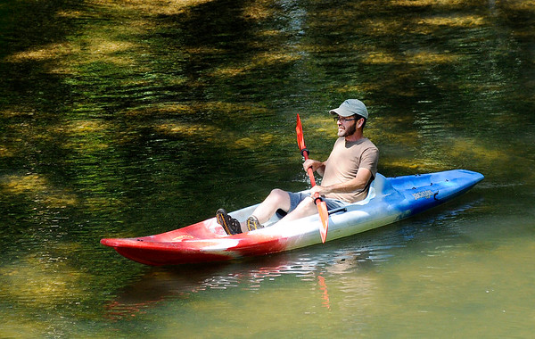 Don Knight | The Herald Bulletin<br /> A kayaker flouts down the White River past Mounds State Park on Wednesday. The National Weather Service is forecasting another nice summer day today but calling for a 40 percent chance of rain to end the work week on Friday.