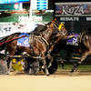 Don Knight   The Herald Bulletin<br /> Check Six (9) driven by Yannick Gingras beats out All Bets Off and Rock N' Roll World to win the Dan Patch Stakes at Hoosier Park on Friday.