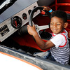 Don Knight   The Herald Bulletin<br /> Greg Burton, 5, sits in race car during the Madison County Community Health Center's annual Back Yard BBQ on Friday. Next week is National Health Center Week.