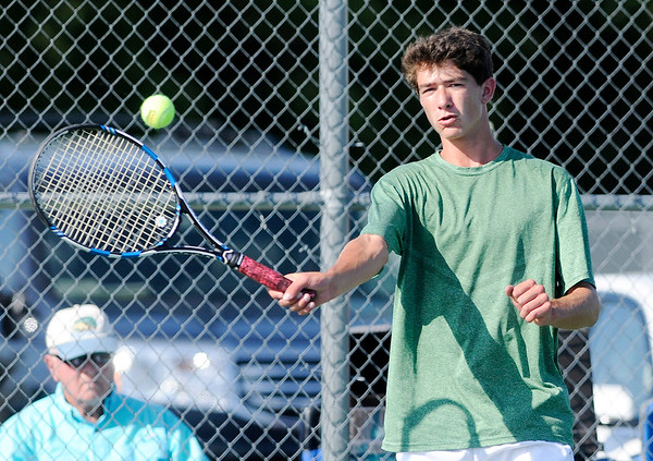 Don Knight | The Herald Bulletin<br /> Pendleton's Walker Stull returns a volley to Lapel's Jesse McCurdy during the Madison County Tennis Tournament final at Lapel on Friday.