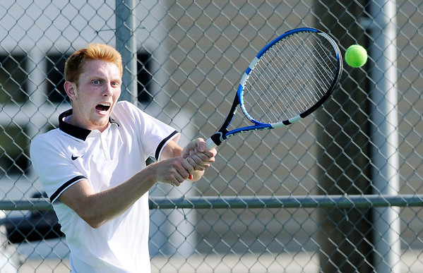Don Knight | The Herald Bulletin<br /> Lapel's Austin Lyons returns a volley to Pendleton Heights Kaleb Alumbaugh during the Madison County Tennis Tournament final at Lapel on Friday.