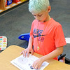Don Knight | The Herald Bulletin<br /> Dexton Hitchens, 9, creates a model of the earth, moon and sun as Pamela Kittle's fourth grade class learns about the solar eclipse on Friday.