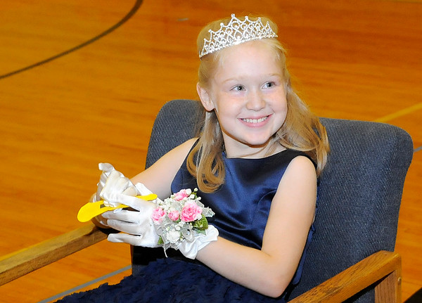 Don Knight | The Herald Bulletin<br /> Susie Clark smiles after receiving her crown and a corsage during Prince and Princess Day at Alexandria Intermediate School on Monday.