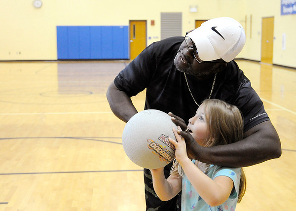 Don Knight   The Herald Bulletin<br /> Jonathan Jackson teaches Christine Craig how to shoot a basket during the after school program at Eastside Elementary on Thursday.
