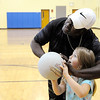 Don Knight | The Herald Bulletin<br /> Jonathan Jackson teaches Christine Craig how to shoot a basket during the after school program at Eastside Elementary on Thursday.