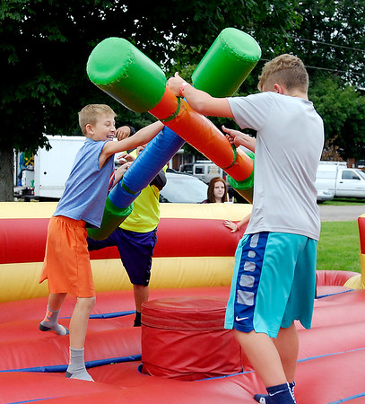 John P. Cleary |  The Herald Bulletin<br /> These kids were having fun jousting on the inflatables Friday evening at the Markleville Jamboree. The Jamboree continues all day Saturday with a parade at 10 a.m., local police and fire department games at 2 p.m., and a laser light show at dusk.