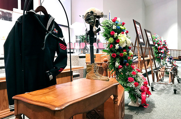 The Navy presented the family of HMI Ryan Lohrey with a military cross including a rifle, helmet and boots at his funeral Friday.