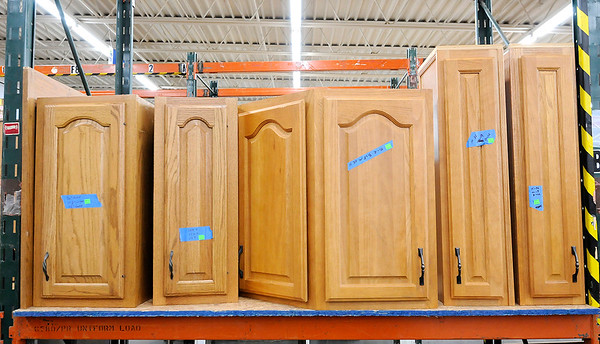 Don Knight   The Herald Bulletin<br /> Kitchen cabinets for sale at the Habitat for Humanity ReSale Store's new location in Chesterfield on Thursday.
