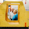Don Knight | The Herald Bulletin<br /> Warren and Nancy Huntzinger listen to their son Jim as he tells them about the LES, Lean Environment Sumulator, at Flagship East/Purdue Polytechnic Anderson on Friday. The simulator is used by the Center for Employee Development.