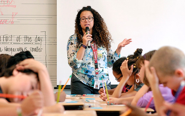 John P. Cleary    The Herald Bulletin<br /> New Anderson Community Schools 4-grade teacher Romelie Pitts gives her students instructions as they go through a word game Wednesday on the first day of classes at Erskine Elementary School.