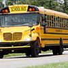 Don Knight | The Herald Bulletin<br /> Buses leave Highland Middle School at the end of the first day of school on Wednesday.