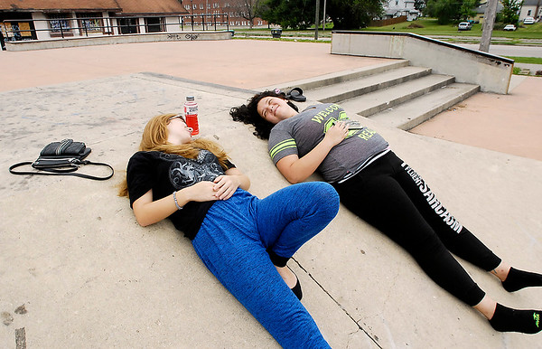 John P. Cleary    The Herald Bulletin<br /> Angel Freeman, 16, and Dana Muriset, 18, relax and enjoy each others company at the Anderson Skate Park Tuesday afternoon. This was their last day of summer vacation as both start back to class Wednesday at Anderson High School as juniors.