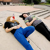 John P. Cleary |  The Herald Bulletin<br /> Angel Freeman, 16, and Dana Muriset, 18, relax and enjoy each others company at the Anderson Skate Park Tuesday afternoon. This was their last day of summer vacation as both start back to class Wednesday at Anderson High School as juniors.