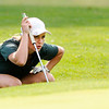 Don Knight | The Herald Bulletin<br /> Pendleton Heights' Danielle Tinsley reads the ninth green as the Anderson Indians hosted the Arabians at Grandview on Thursday.
