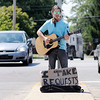 Don Knight | The Herald Bulletin<br /> Street musician Derek O'Brien, who performs under the pseudonym Dobby, entertains motorists at the intersection of Charles Street and Scatterfield Road on Thursday. O'Brien plays rock, blues and some Irish folk songs.