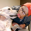 John P. Cleary |  The Herald Bulletin<br /> Judd, a golden retriever therapy dog, gives Susan Myrick a big kiss as he visits her in the Oncology Department while making his rounds Tuesday at St. Vincent Mercy Hospital in Elwood.