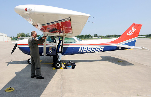 Don Knight   The Herald Bulletin<br /> From left, Sean Meyer and Michael McGregory prepare to fly out of the Anderson Airport in a Cessna 172 on a mission in support of the Kentucky Civil Air Patrol during Civil Air Patrol training Saturday at the Anderson Municipal Airport. The operations Saturday included practice search and rescue and disaster relief missions. The Civil Air Patrol has a fleet of 560 aircraft and conduct 90 percent of inland search and rescue in the U.S. as tasked by the Air Force Rescue Coordination Center.