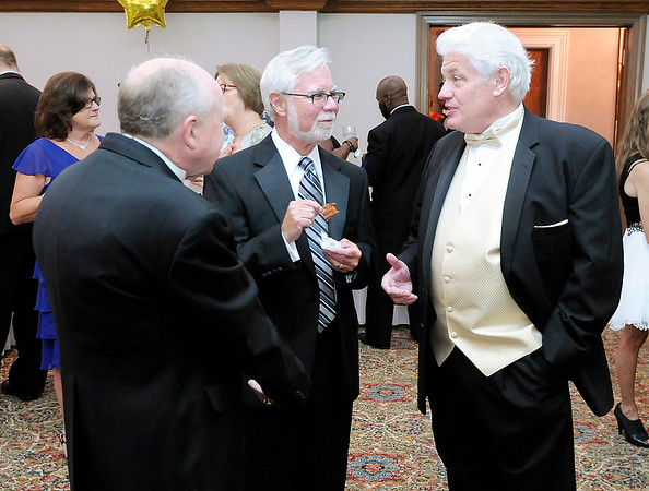 Don Knight   The Herald Bulletin<br /> Anderson Mayor Thomas Broderick Jr. talks to Sen. Tim Lanane and Roger Reed during the Mayor's Charity Ball at the Anderson Country Club on Saturday.