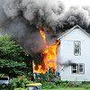 Don Knight | The Herald Bulletin<br /> This home in the 900 block of of East 10th St. was destroyed by fire on Tuesday.