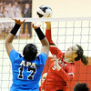 Don Knight | The Herald Bulletin<br /> Liberty Christian's Sarah Aikin attacks the ball as APA's Ailyah Sawyer tries to bock her on Tuesday.