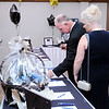 Don Knight | The Herald Bulletin<br /> Brian Frazier and Debbie McDaniel make a bid on the silent auction during the Mayor's Charity Ball at the Anderson Country Club on Saturday.