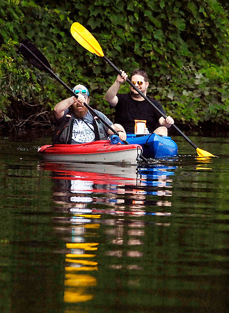 John P. Cleary    The Herald Bulletin<br /> Enjoying the day on the water kayaking, with warm sun, light winds, and calm waters are Eliot Reed and Matt Adair as they paddle around Shadyside Lake Monday afternoon.