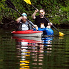 John P. Cleary |  The Herald Bulletin<br /> Enjoying the day on the water kayaking, with warm sun, light winds, and calm waters are Eliot Reed and Matt Adair as they paddle around Shadyside Lake Monday afternoon.