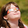 Don Knight | The Herald Bulletin<br /> Sophia Bartolotti, 9, watches the solar eclipse at Lapel Elementary on Monday. It was partly cloudy but students were still able get a good look at the eclipse.